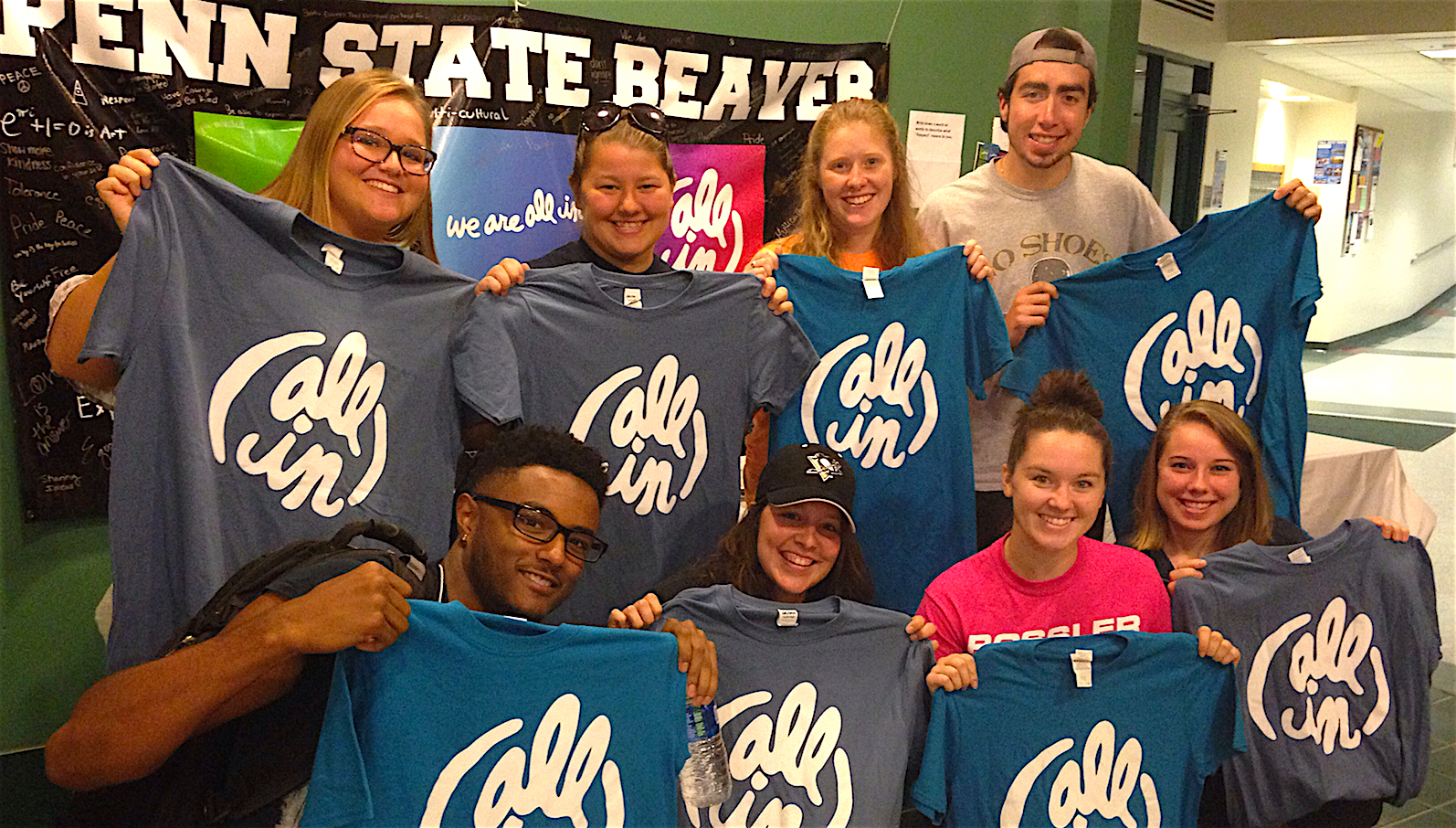 "Eight Beaver students pose with their ""All In"" T-shirts in the Brodhead Bistro."