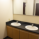 Two sinks and a large mirror outside of the bathroom for the Nittany I Apartments