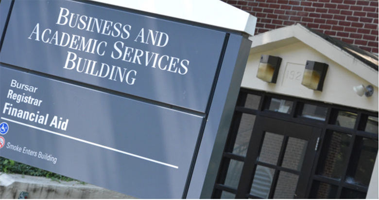 photo of wayfaring signage in front of the Business Services Building at Penn State Schuylkill