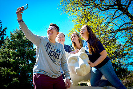 Students posing for photos at the lion shrine.