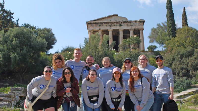 Penn State Schuylkill students pose for a photo in front of ancient Greek ruins.