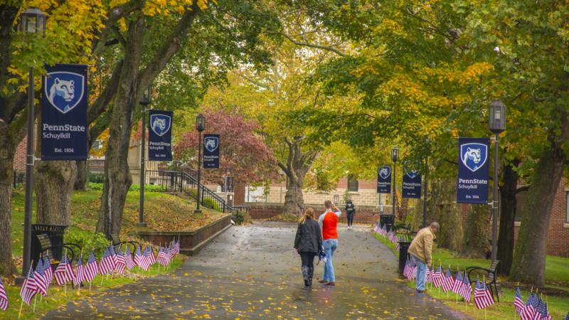 Students walk along Schuylkill mall walk after some midday autumn rainfall.