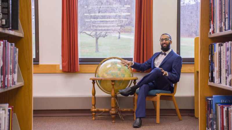 Harnoor Singh, former Schuylkill student, sits in the library.