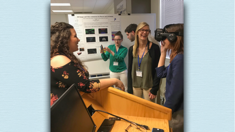 Dr. Gallis' students explain their recent physics projects.