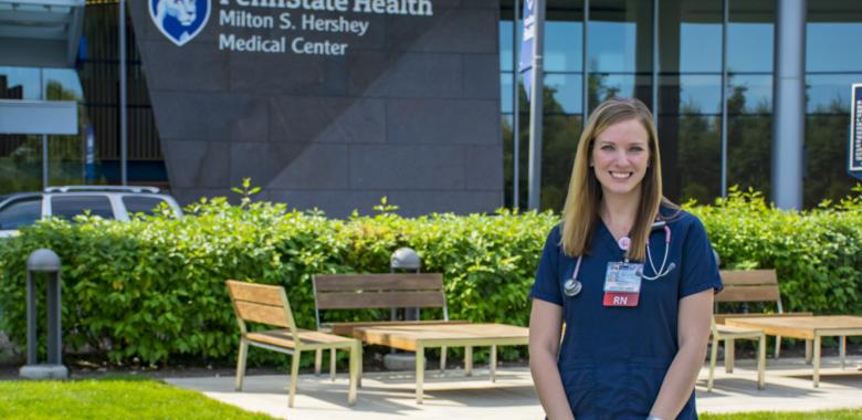 Anastasia Barnhardt poses in front of Penn State Health Milton S. Hershey Hospital.
