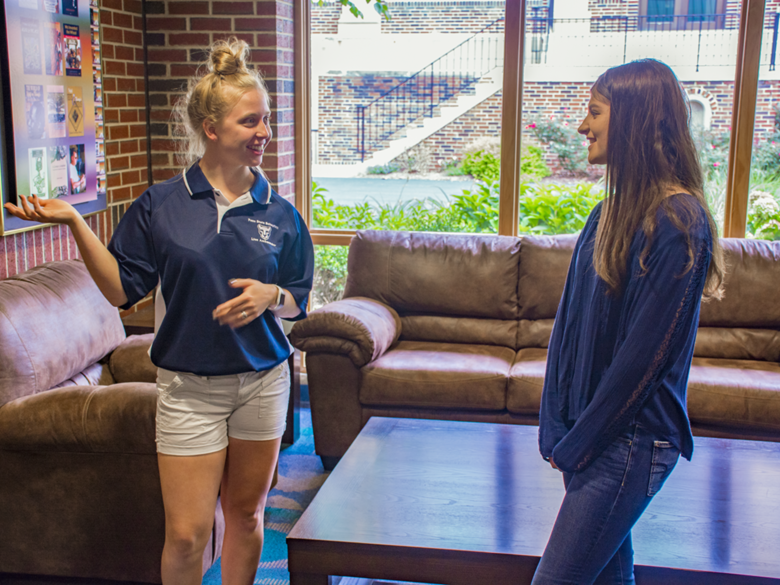 Lion Ambassador Angelica shows prospective student Lauren around the Health & Wellness Building