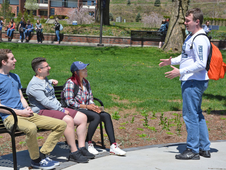 Students sit around fountain at Penn State Schuylkill