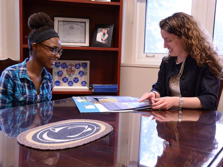 An admissions counselor discusses academic options with a prospective student.