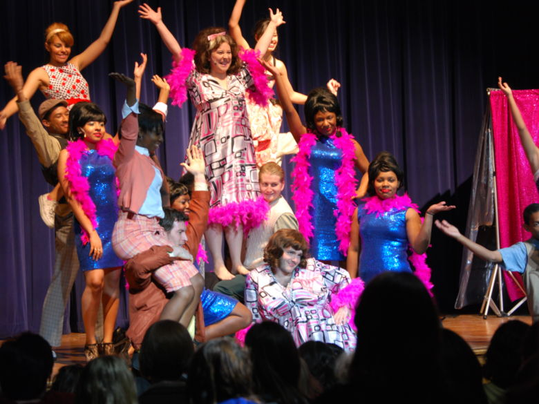 Students from Hairspray production show off for their grand finale
