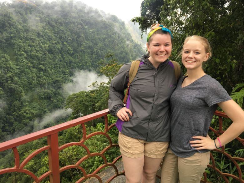 Students Alyssa and Marla take in a breathtaking overlook in Costa Rica.