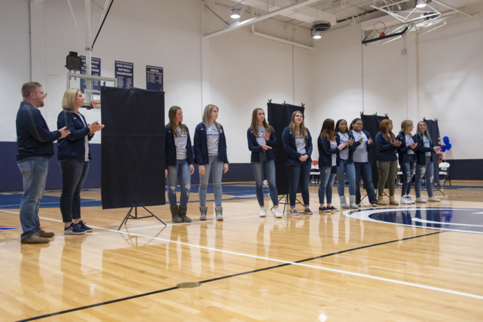 The 2019 Women's Volleyball team at the championship banner unveiling.