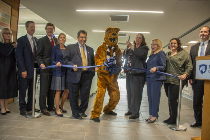 Key players in the dining center renovation and expansion project pause to cut the ribbon