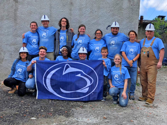 Penn State students stand in front of their Habitat for Humanity build site in Portugal