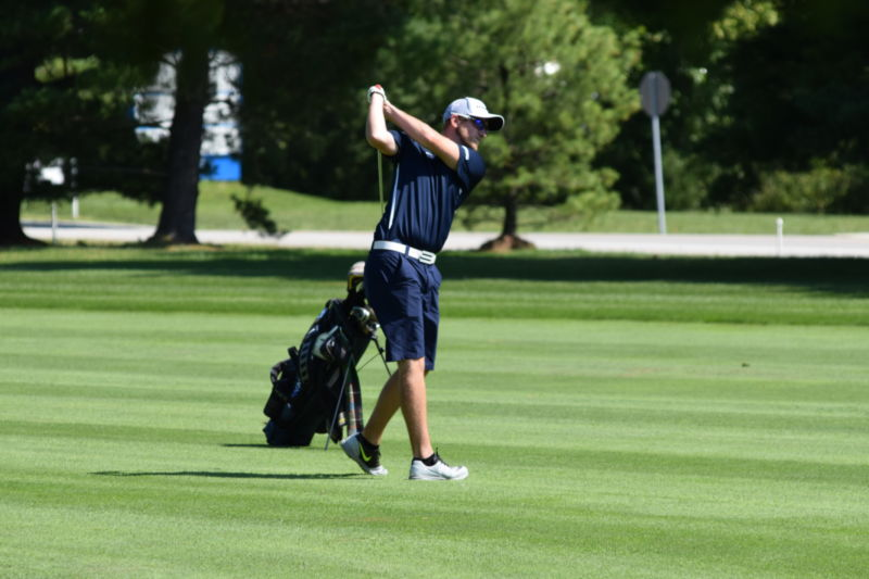 Student golfer tees off