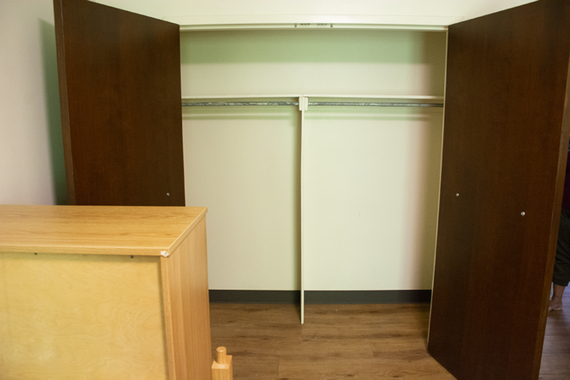 A double-door walk-in closet in the Nittany I Apartments