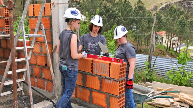 Penn State Schuylkill students Marla, Ian, and Alyssa build a wall in their Portugal Habitat for Humanity build site.