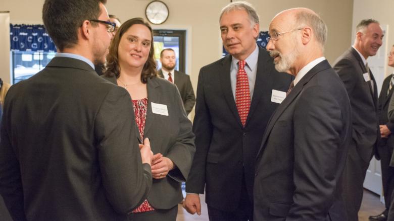 Governor Tom Wolf speaks to Carmen Cicioni, a seed money winner from Schuylkill's LionLaunch program.