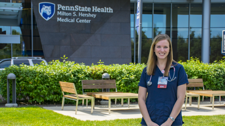 Anastasia Barnhardt poses in front of Penn State Health Milton S. Hershey Hospital.