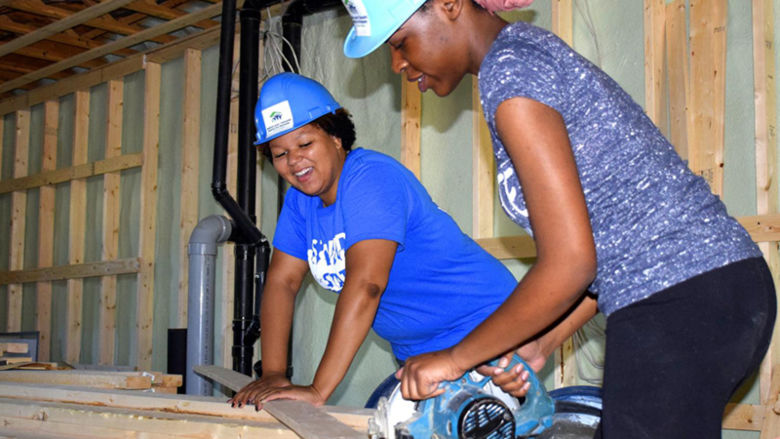 Valerie and Darlyncia working with a table saw