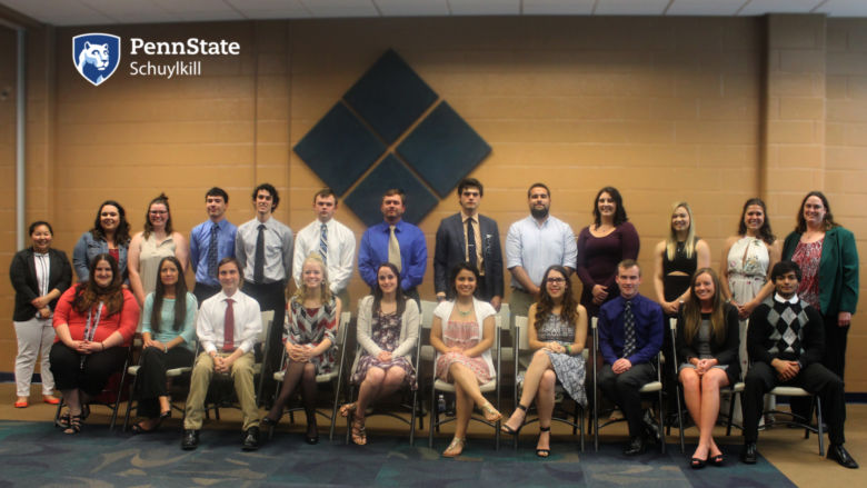 A group of students, faculty and staff pose for a photo after being inducted into Beta Beta Beta, the National Biological Honors Society.