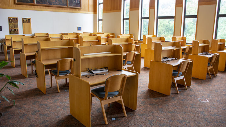 Several rows of study carrels stretched across a wide space