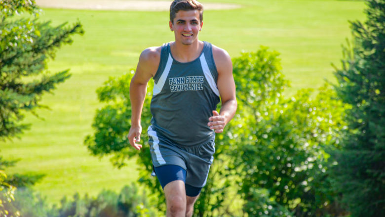 Penn State Schuylkill athlete Nico Granito warms up for a cross country match.
