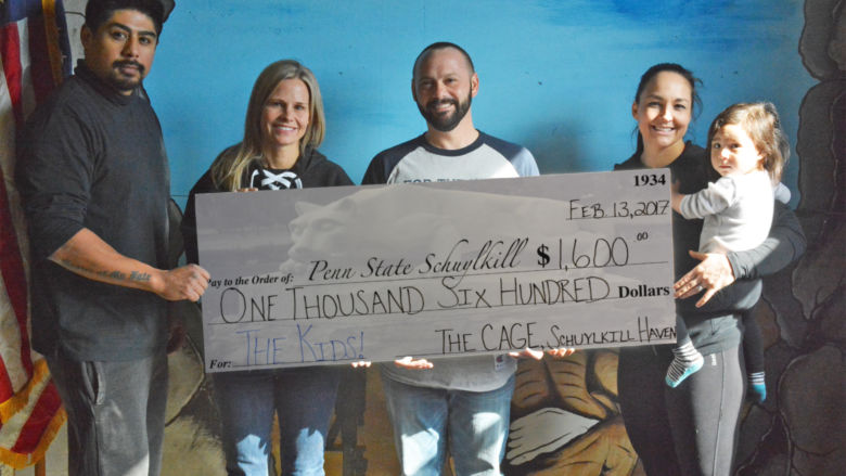 Schuylkill THON Advisers Accept Event Donation Check from The CAGE, Local Gym