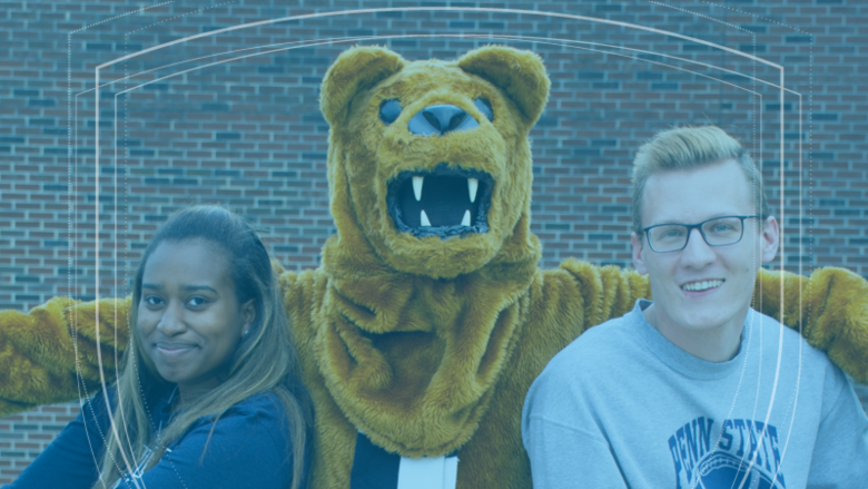 The Nittany Lion mascot wraps its arms around two Penn State students.