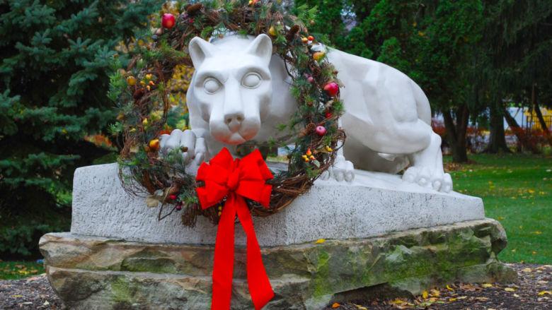 Schuylkill's lion shrine dons a festive holiday wreath.